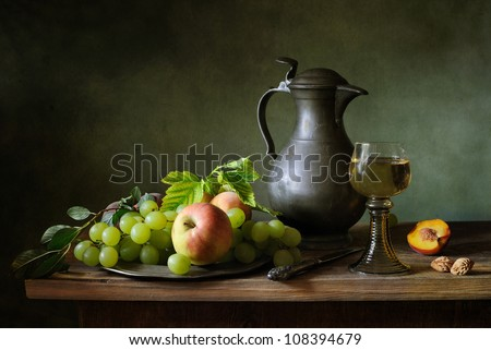 Still life with grapes and apples - stock photo