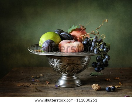 Still life with grapes and pomegranate - stock photo