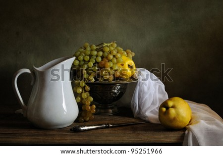 Still life with grapes and quinces - stock photo