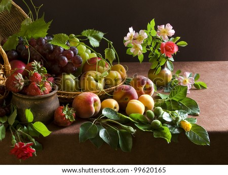 Still life with grapes, peaches and rose - stock photo