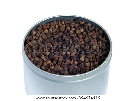 Still-life with gray color metal jar full of black pepper grains isolated on white background. Top view photo closeup