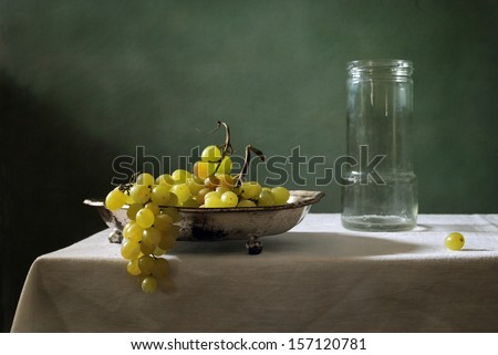 Still life with green grapes - stock photo