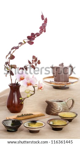 Still life with green tea and flowers.