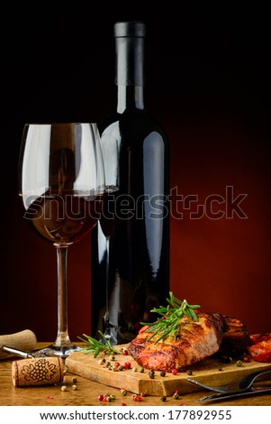 still life with grilled meat, rosemary and red wine - stock photo