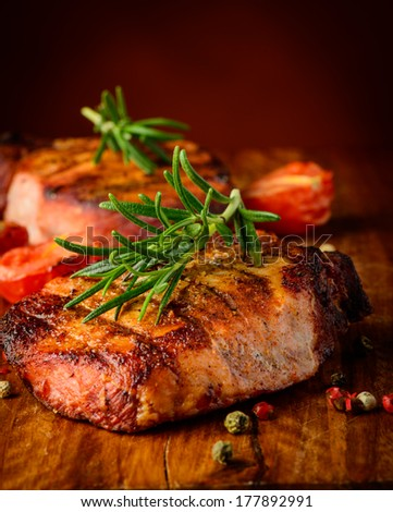 still life with grilled meat steak closeup detail and spices - stock photo