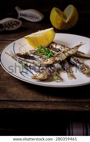 Still life with Grilled Sardines, Herbs and Lemon - stock photo