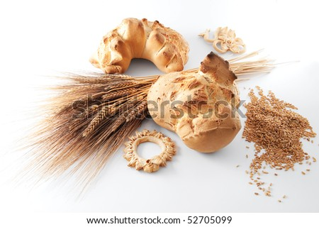 still life with hand made bread, wheat and grains - stock photo