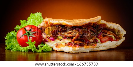 still life with homemade kebab and fresh vegetables - stock photo