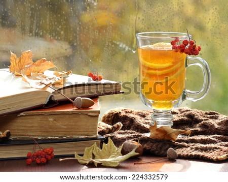 Still life with hot tea in autumn decoration  - stock photo