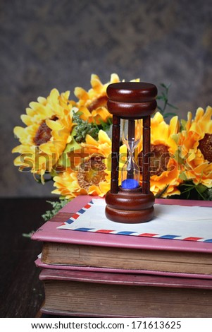 Still life with  Hourglasses and old books. - stock photo