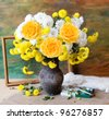 Still life with huge bunch of autumn flowers and roses, paints collection and wooden frame on painting background - stock photo