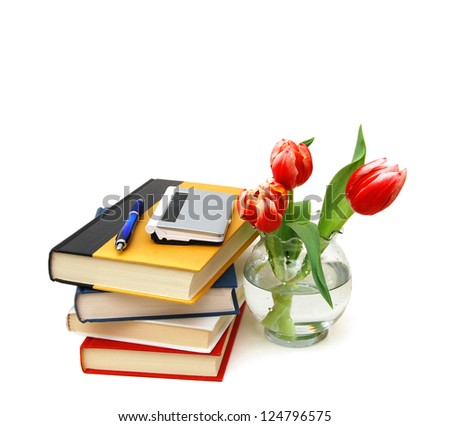 still life with huge bunch of spring tulips and books isolated on white background - stock photo