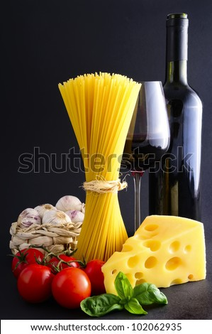 still life with italian spaghetti pasta ingredients and red wine - stock photo