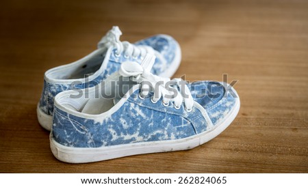 still life with jean sneakers - stock photo