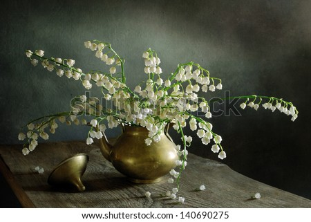 Still life with lilies of the valley - stock photo