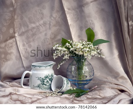 Still life with lily-of-the-valley flowers in a vase - stock photo