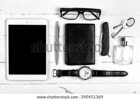 Still life with male accessories on white wooden table - stock photo