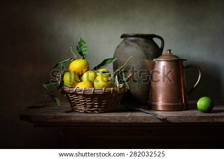 Still life with mandarines and a coffee pot - stock photo