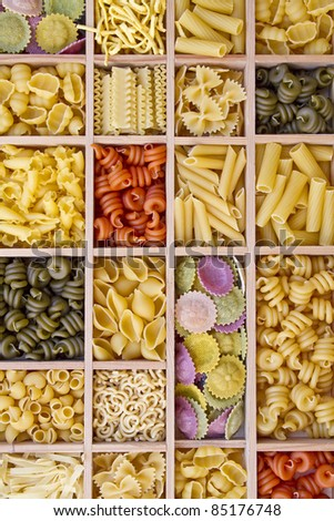 Still life with many different types of pasta - stock photo