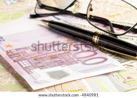 still life with money on the map - stock photo