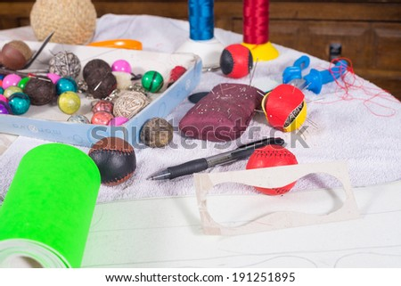 Still life with objects needed to craft traditional pelota balls - stock photo