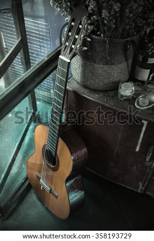 Still life with old acoustic guitar - stock photo
