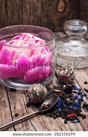 still life with old cups of brewed herbal tea and scattered welding. Selective focus. Photo tinted - stock photo