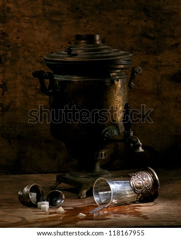 Still life with old samovar and sugar on a wet table