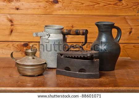 Still-life with old things on brown wooden background - stock photo