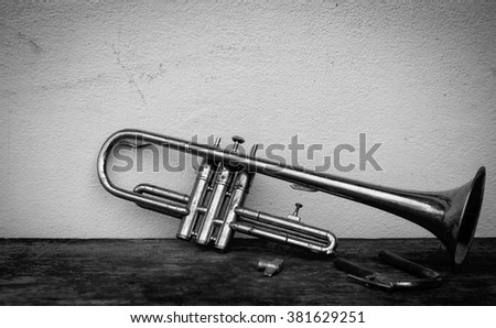 Still life with old trumpet in black and white tone. vignette style.  - stock photo