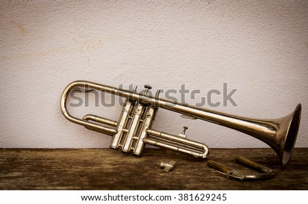 Still life with old trumpet in dark tone. vignette style.  - stock photo
