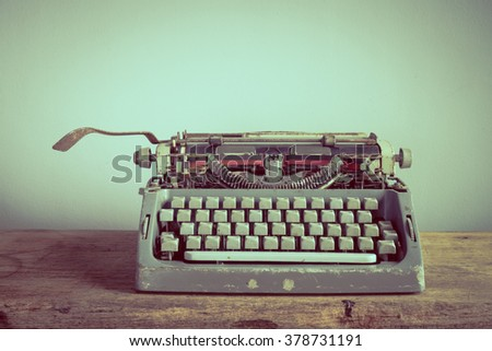 Still life with old typewriter on wooden table - stock photo