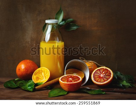 Still life with orange fruit and juice on wooden table. Painting style.  - stock photo