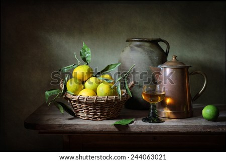 Still life with oranges and a glass of wine - stock photo