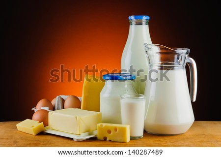 still life with organic dairy products, milk, cheese, butter and eggs - stock photo