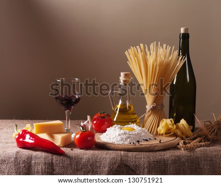 still life with pasta, vegetables and wine - stock photo