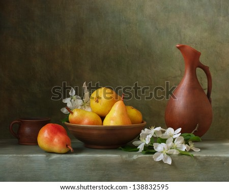 Still life with pears in a bowl - stock photo