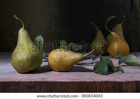 still life with pears on a wooden table - stock photo
