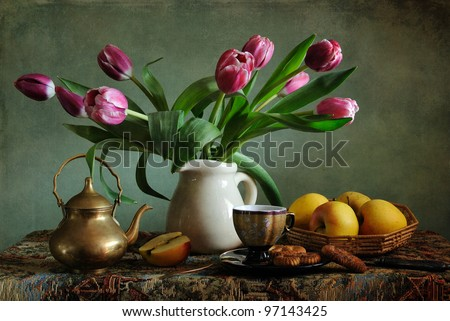 Still life with pink tulips and apples - stock photo
