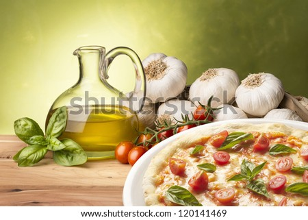 still life with pizza on wood table - stock photo
