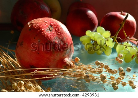 Still life with pomegranates - stock photo