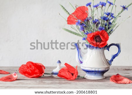 still life with poppies and cornflower - stock photo