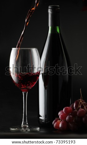 still life with pouring red wine into glass