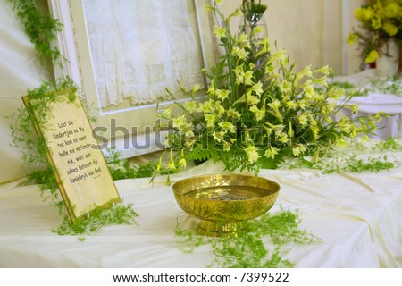 Still-life with prayer note and vase (soft focus on vase). Shot in Caledon, Western Cape, South Africa.