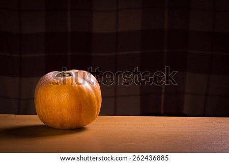 Still Life With Pumpkin On Dark Blured Square Background With Copy Space - stock photo