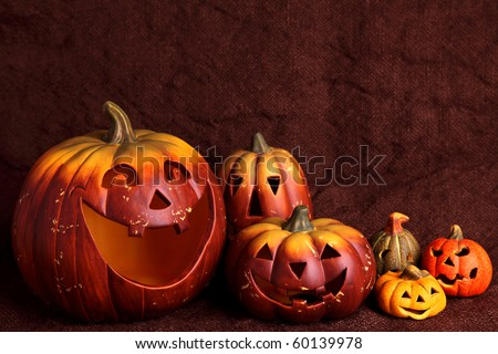 Still life with pumpkins, brown background - stock photo