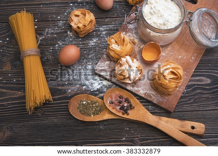 still life with raw homemade pasta and ingredients for pasta.till life with raw homemade pasta and ingredients for pasta.process cooking pasta - stock photo