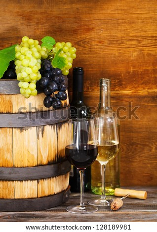 Still life with red and white wine, bottles and barrel