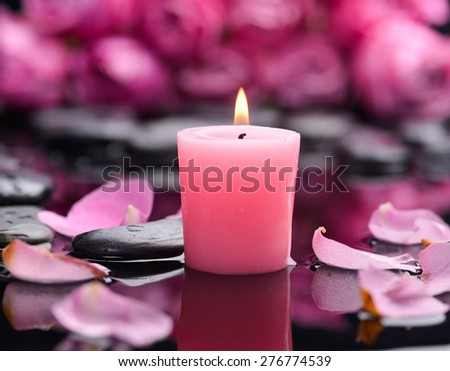 Still life with Red rose ,petals,candle and wet stones - stock photo