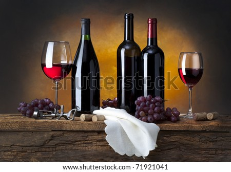 still life with red wine and drapery - stock photo